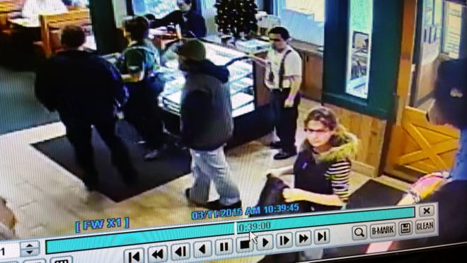A submitted photo of surveillance video footage showing a man and woman at the entrance of the Black Bear Diner in south Reno. The suspects are believed to be involved in stealing another woman's Jeep twice in a row, along with her credit cards and cash. Police said the suspects were spotted using the stolen credit cards at the diner earlier this month.