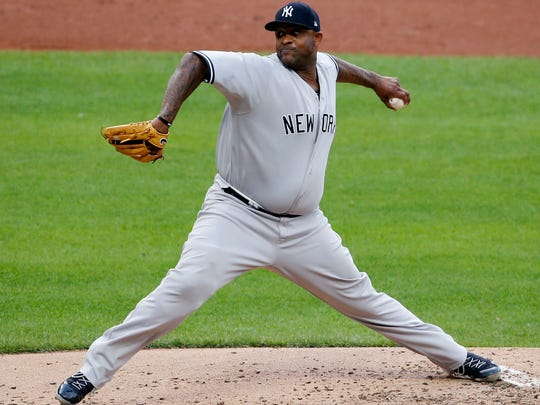 New York Yankees starting pitcher CC Sabathia delivers against the Cleveland Indians during the first inning of a baseball game, Saturday, July 14, 2018, in Cleveland.