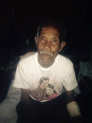 "Funchu Tamang, 101, sits on a bed in a hospital in Nuwakot district on May 3, 2015 around 80 kilometres (50 miles) northwest of Kathmandu where he was taken after being rescued from his collapsed home a day earlier.  The 101-year-old man was found alive at his ruined home a week after Nepal's earthquake claimed at least 7,200 lives, as the government warned on May 3 the death toll will climb ""much higher"".  Police had initially said that Tamang was trapped under the rubble of his home ever since the quake struck on April 25, but they later said he was in fact rescued from his garden where he had been sheltering since the disaster.  AFP PHOTOSTR/AFP/Getty Images ORIG FILE ID: 540356220"