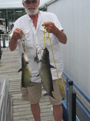 Dennis Hymer, Strafford, with a channel catfish and