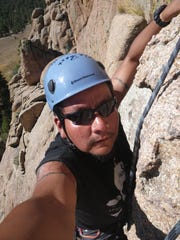 Rob Pioche climbs at Tres Piedras outside Taos in November.
