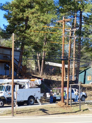 Crews from PNM replaced an old power pole with a new taller version Tuesday on Sudderth Drive in Ruidoso.