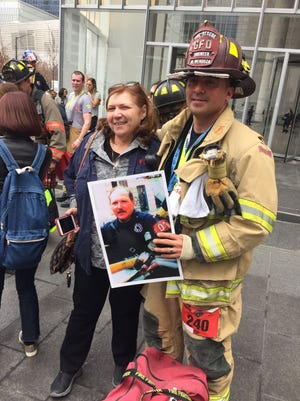 Gallatin firefighter Mario Mendoza stands with Janice Testa whose brother, NYFD firefighter Henry Miller Jr., was killed on 9/11. Mendoza participated in the second annual New York City Firefighter Stair Climb in Miller's honor on March 13.