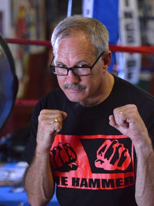 Staunton Boxing Club owner and trainer Bruce Frank supports the change that eliminated the requirement for headgear in amateur fights.