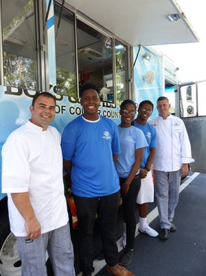 From left to right, Anastasios Banos, Jhonnan Desinor, Wendy Joseph, Clairvens Florexil and Geoff Novins at The Blue CanTEEN.