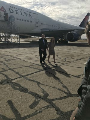 Holly Rick and Gene Peterson tied the knot in the aisle ofa Boeing 747 -- the plane that brought them, a flight attendant and pilot,together nine years ago in Kuwait.