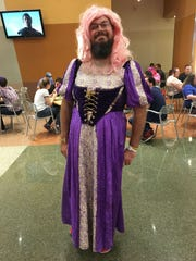 Scott Moorehead, 31, from Tempe, rummaged through his girlfriend's closet for this princess costume, seen at Phoenix Comic Fest, Thursday, May 24, 2018.
