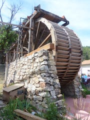 The water wheel looks study and intac despite the fire.