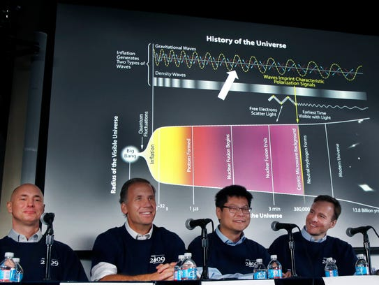 Scientists, from left, Clem Pryke, Jamie Bock, Chao-Lin Kuo and John Kovac smile during a news conference at the Harvard-Smithsonian Center for Astrophysics in Cambridge, Mass., Monday, March 17, 2014, regarding their new findings on the early expansion of the universe. Scientists say that the universe was born almost 14 billion years ago, exploding into existence in an event called the Big Bang. Now these researchers say they?ve spotted evidence that a split-second later, the expansion of the cosmos got a powerful-jump start. Experts called the discovery a major advance if confirmed. (AP Photo/Elise Amendola)