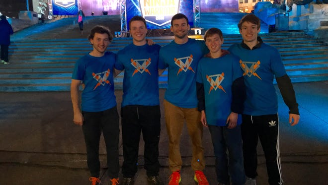 "Drew Knapp of Suamico, center, competed on ""American Ninja Warrior"" in April in Indianapolis. On Monday's episode, he advanced to the next round by completing the obstacle course with the 14th-fastest time."