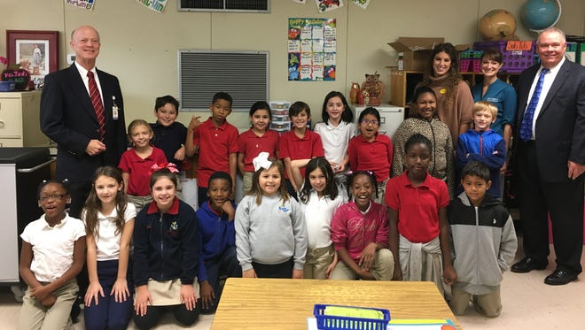: Representatives with Our Lady of Lourdes and Woman's Foundation visit Ms. Junot's 3rd Grade Class at Ridge Elementary to see the students run, jump, dance and stretch using GoNoodle, an online suite of interactive activities created to improve the student's health and boost their cognitive processing, focus and academic performance. Elementary students across 31 area elementary schools have access to GoNoodle Plus for an additional three years thanks to Our Lady of Lourdes and Woman's Foundation. Pictured left to right – Jim Schellman, Our Lady of Lourdes, VP Mission Integration; Ms. Junot's 3rd grade class; Rachel Gibson, Woman's Foundation, Community Education Coordinator; Amy Broussard, Woman's Foundation, Executive Director; Bud Barrow, Our Lady of Lourdes, CEO.