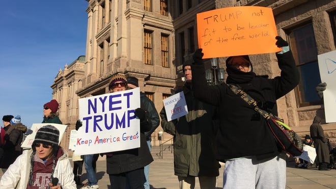 Protestors gather outside the state capitol in Austin Monday to protest the election of Donald Trump by Texas's 38 Electoral College electors. The electors were scheduled to meet in the capital later in the day to cast their vote for president.