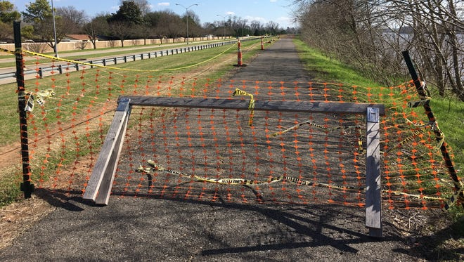 A portion of the Arthur Ray Teague Parkway multi-use trail has been blocked off for numerous months.