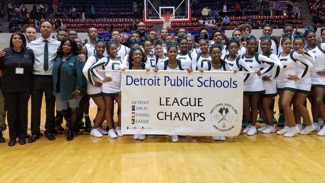 Members of Cass Tech's boys basketball team celebrate winning their first Detroit Public Schools League championship since 1998 on Saturday, Feb. 18, 2017, at Calihan Hall. The Technicians beat Detroit King, 59-47.