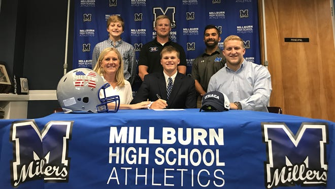 Millburn graduate Drew Pickard commits to play football at Ithaca with his family, coach Chris Dreschel (top middle) and athletic director Frank Bifulco (top right).