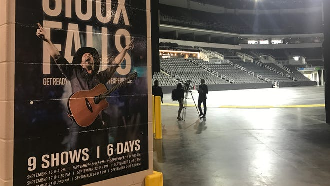 SMG assistant general manager Chris Semrau talks with a reporter inside an empty Premier Center where Garth Brooks will perform nine shows this month.