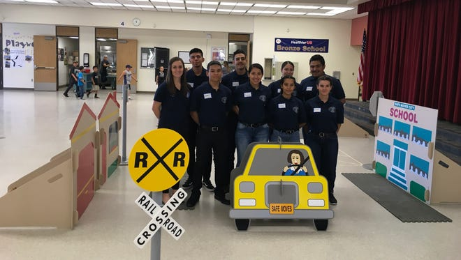 Fun and colorful props are a part of teaching pedestrian safety, a program supported by these Desert Hot Springs High School Public Safety Academy students.