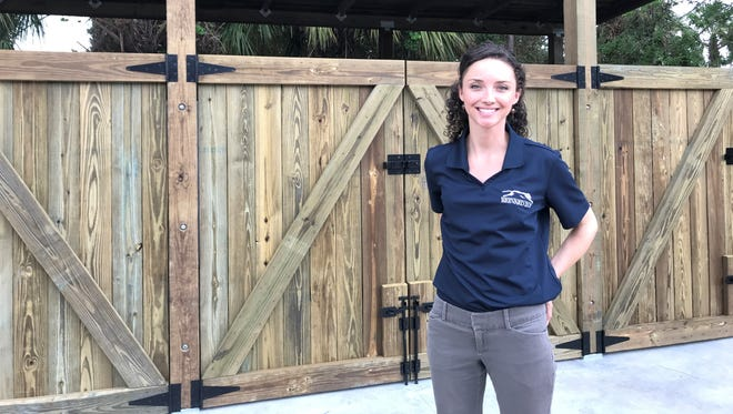 Amy Reaume, conservation manager at the Brevard Zoo, stands in front of the zoo's new composting facility being constructed using a grant from Waste Management.