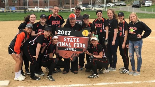 The Lucas Lady Cubs honored their 2017 state Final Four team with a wooden banner which will hand in the gym at Lucas High School before their game on Monday.