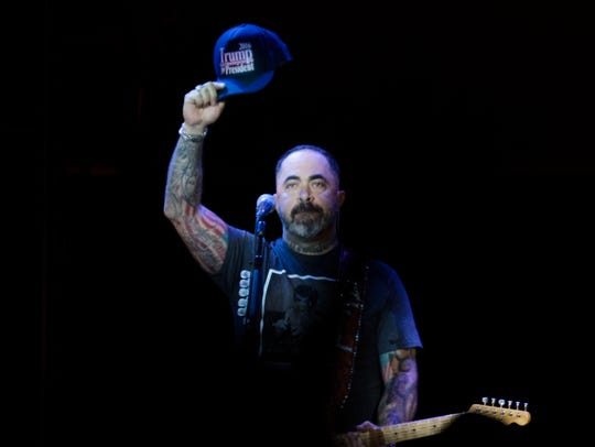 "Aaron Lewis raises his hat which reads ""Trump for President"
