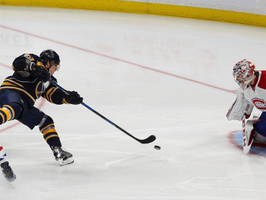Buffalo Sabres forward Tyler Ennis (63) shoots on Montreal Canadiens goalie Carey Price (31) during the third period of an NHL hockey game, Wednesday, April 5, 2017, in Buffalo, N.Y. (AP Photo/Jeffrey T. Barnes)