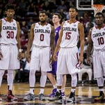 Nov 27, 2015; Columbia, SC, USA; South Carolina Gamecocks forward Chris Silva (30) and guard Sindarius Thornwell (0) and guard PJ Dozier (15) and guard Duane Notice (10) watch a teammate attempt a technical free throw against the Lipscomb Bisons in the first half at Colonial Life Arena. Mandatory Credit: Jeff Blake-USA TODAY Sports