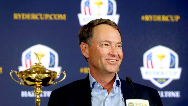 Davis Love III smiles during a news conference announcing him as the 2016 U.S. Ryder Cup captain, Tuesday at PGA of America in Palm Beach Gardens, Fla.