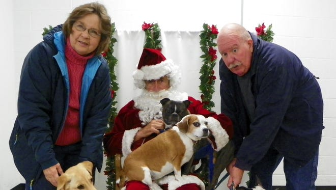 Greg and Kathy Wheeler brought five furry members of their family to be photographed with Santa.