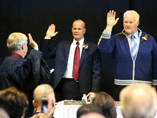 Elmira judge Stephen Forrest swears in City of Elmira councilmen, from left, James D. Water, Brent A. Stermer and Joseph H. Duffy on Friday during inauguration ceremonies.