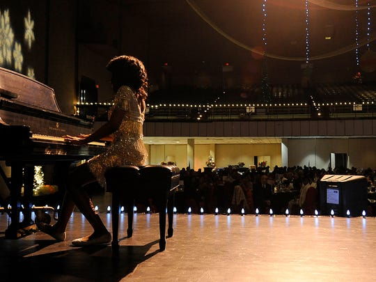 Asia Hickman performs during the 100 Black Men of West Tennessee's 24th Annual Scholarship Benefit Gala at the Carl Perkins Civic Center in Jackson Friday.