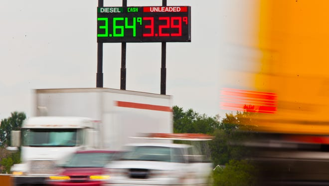 Fuel prices at a gas station on U.S. 169 are seen between northbound and southbound traffic on Interstate 29 in St. Joseph, Mo., Thursday, May 22, 2014. For the third year in a row, the national average of gasoline prices will be within a penny or two of $3.64 per gallon during Memorial Day.