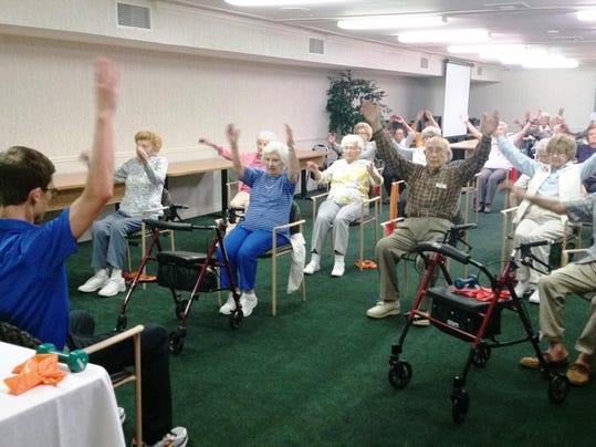 Photo 1 - Morning Stretch Class at Waltonwood at Twelve Oaks