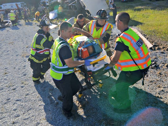 EMTs transport someone from the scene of a crash on I-95.
