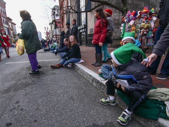 Anthony Clark. 5, right, holds his letter as he waits for a elf during the Nov. 26 parade.