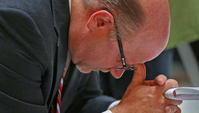 Kevin Baird, the field director for the Indiana Pastors Alliance, lowers his head in prayer during the Indiana Pastors Alliance prayer rally at the Statehouse, Tuesday, November 17, 2015.