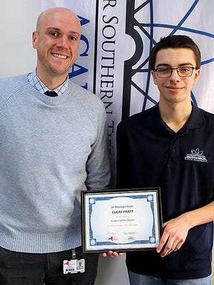 Lucas Pratt, right, is presented the Student of the Month award by STEM Academy Principal Rob Sherburne.