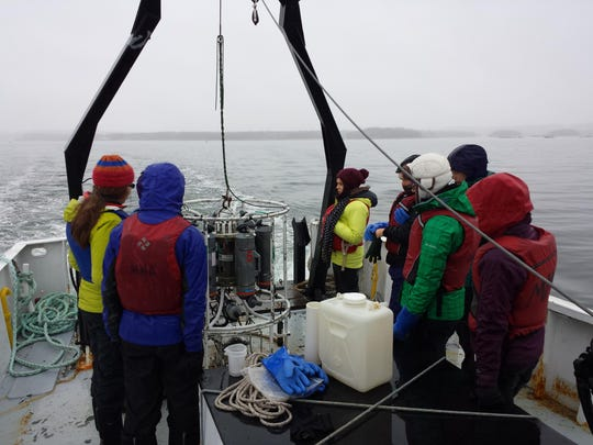 Students from Coastal Studies for Girls collect sea water samples aboard a Maine Maritime Academy research vessel in mid-April.