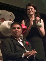 Former heavyweight boxing champion Muhammad Ali and Miss America 1998 Kate Shindle at the Olender Foundation Awards in 1997.