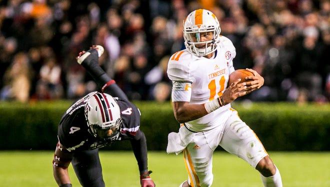 Tennessee Volunteers quarterback Joshua Dobbs (11) scrambles away from South Carolina Gamecocks linebacker Bryson Allen-Williams (4) in the first quarter at Williams-Brice Stadium.