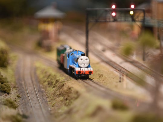 A model Thomas the Tank Engine chugs along during the