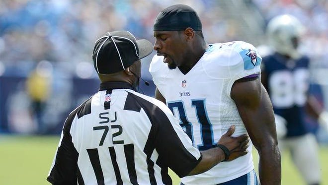 Tennessee Titans strong safety Bernard Pollard talks with side judge Michael Banks in the first quarter against the Cowboys.