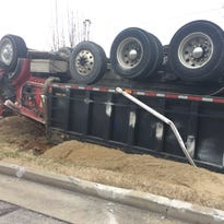 Driver in overturned Robertson dump truck suffers minor injuries