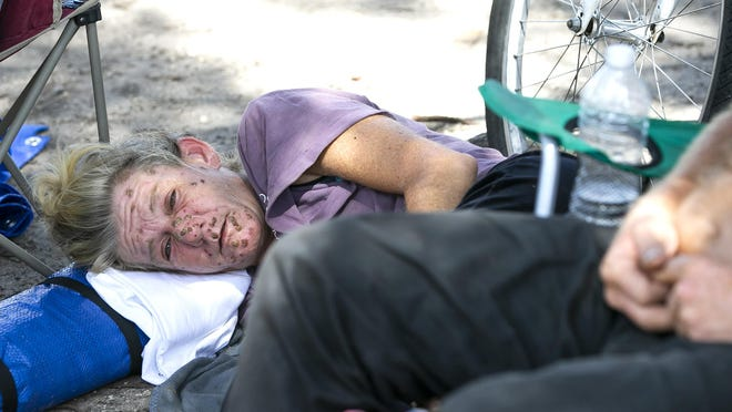 Susan Fredericks, who has been homeless for the past 10 years, rests while congregating in an Ocala parking lot earlier this year. Combating homelessness is one of the United Way of Marion County's top priorities for the next two years.