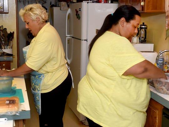 Cousins Vanessa Lewis and Hilda Elliott-Brooks prepare