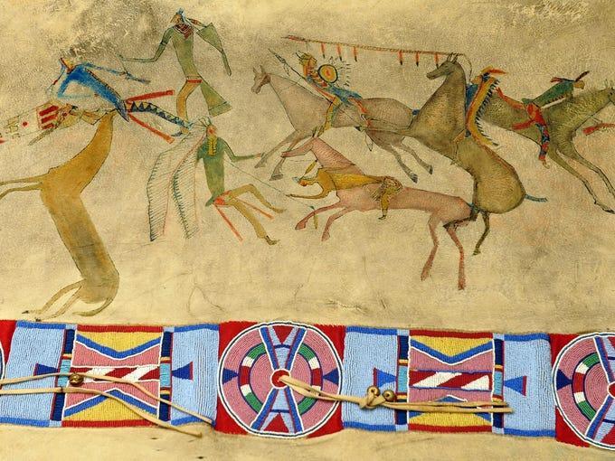 Beadwork and ledger art on a buffalo hide robe painted