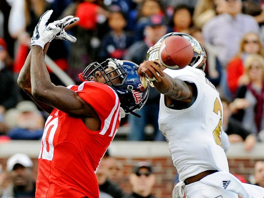 Mississippi State defensive back Will Redmond (2) breaks up a pass intended for OleMiss wide receiver Vince Sanders (10).