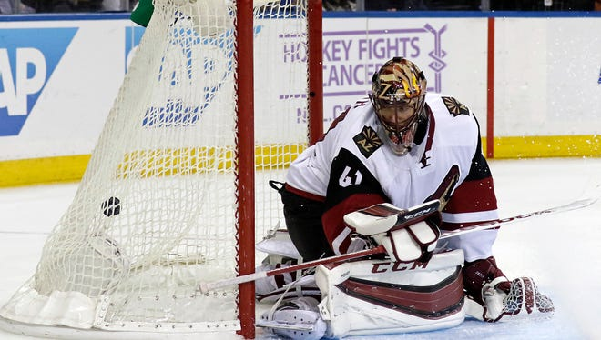 Oct. 22, 2015; New York; Arizona Coyotes goalie Mike Smith looks back at a goal scored by New York Rangers left wing Chris Kreider during the second period of an NHL hockey game at Madison Square Garden.
