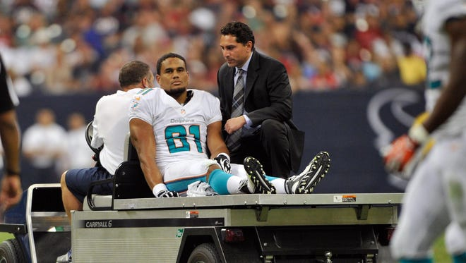 Miami Dolphins tight end Dustin Keller (81) is carted off the field with an injury during the first half against the Houston Texans at Reliant Stadium.