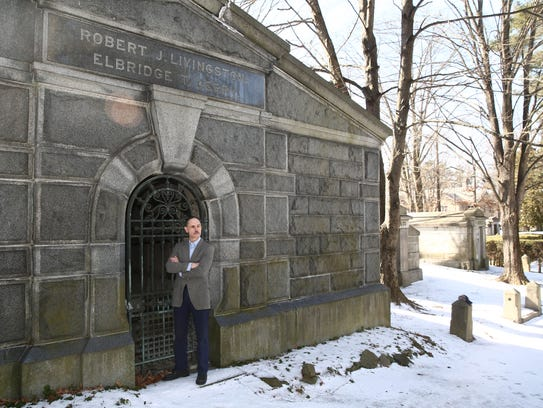 Peter Bedrossian is a re-enactor who portrays Elbridge T. Gerry outside his crypt in Saint James Church in Hyde Park on Feb. 13, 2018.