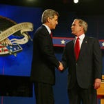 George W. Bush and John Kerry shake hands at the beginning of the third presidential debate at Arizona State University on Oct. 13, 2004, in Tempe, Ariz.